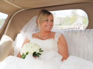 Arrival of the bride at Carden Park Shooting Lodge
