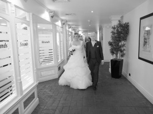 Bride and Dad on the way to the ceremony at Carden Park