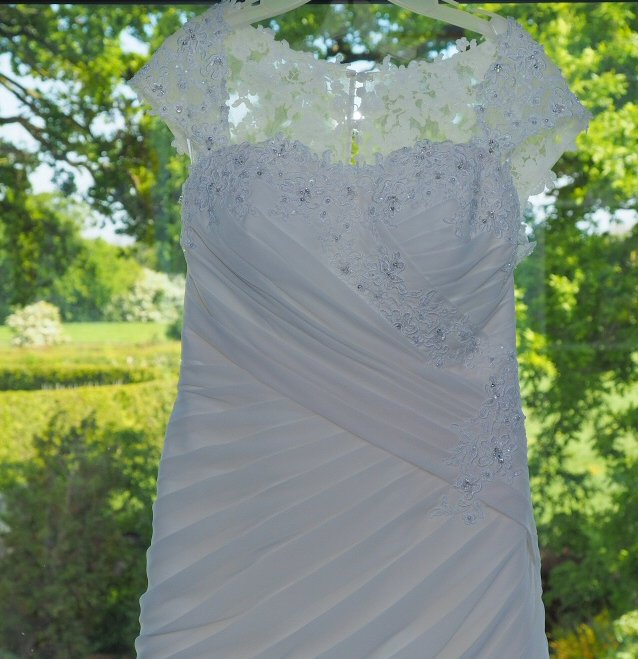 Bridal preps - lovely shot of Claire's wedding dress