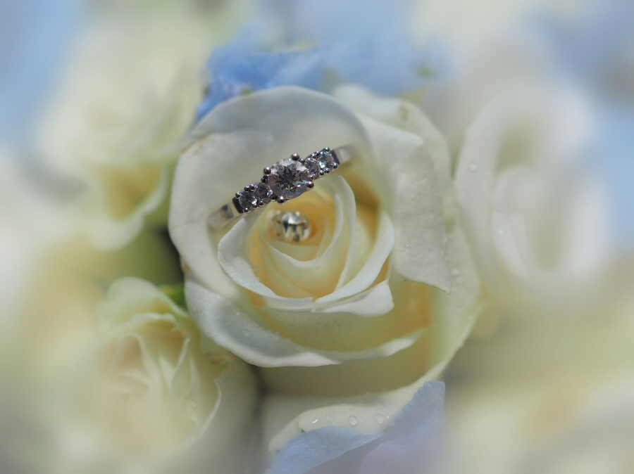 Our signature shot of the engagement ring and bridal bouquet