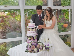 Staged Cutting the cake at the wedding breakfast in The Lion Quays