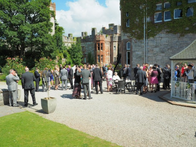 The guests at the castle enjoying the entertainment in the sun