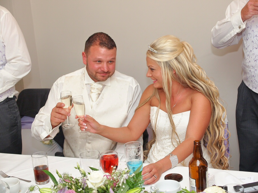 Bride and Groom toast their future