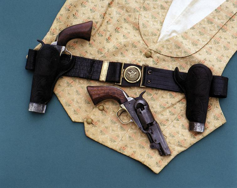 "For many years, these Colts hung in a Barbary Coast saloon, along with this tooled San Francisco, ""Main & Winchester""-made holster and belt rig. This rare set of three-inch '49 Pocket models, with serial numbers only 24 digits apart, have the factory-added loading levers.– Courtesy Herb Lyman Collection –"
