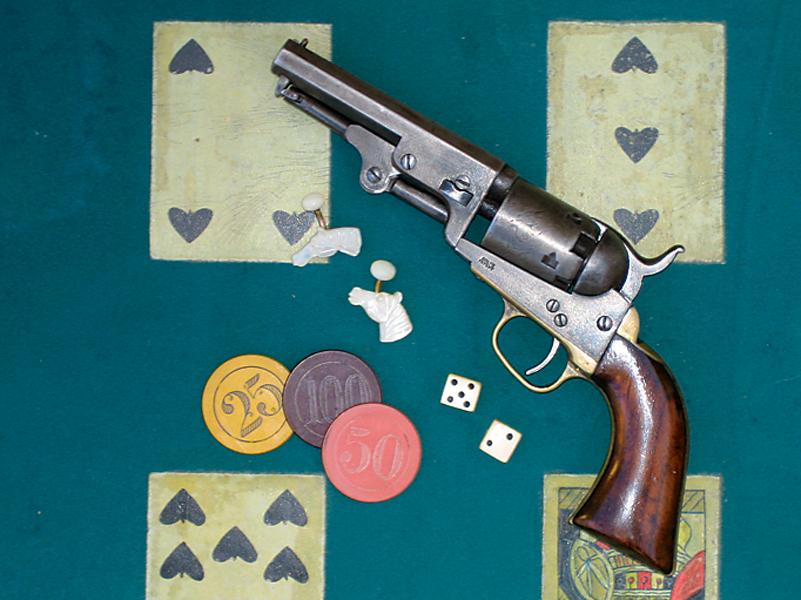 "Laid out among some mid-19th-century gambling gent's paraphernalia—a pair of mother of pearl horse head cuff links, dice and chips—this four-inch barreled 1849 Colt is right at home, since it may well have served as a ""fifth ace"" in more than one tight spot.– Courtesy Phil Spangenberger Collection –"