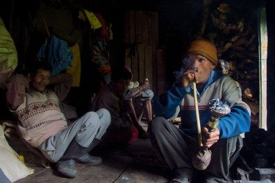 Porters enjoy a rough shisha in the high mountains of the Indian Himalayas en route to the Pindari Glacier.