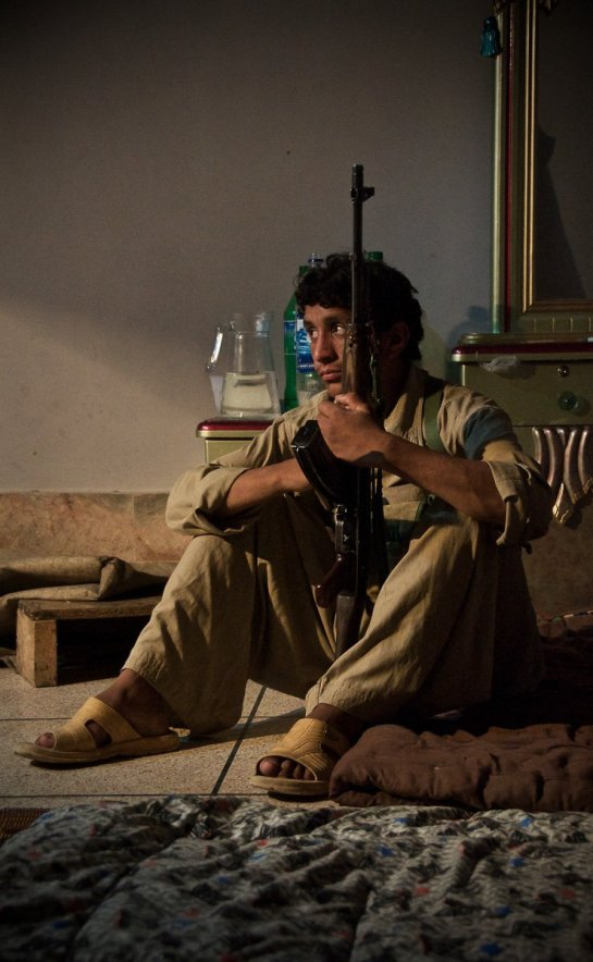 A 16-year-old member of a security detail and a tribal militia in Swat Valley near Mingora, Pakistan, relaxes for a few quiet moments in the captured house of a Taliban commander. The Pakistani Army has been urging the formation of these tribal militias to combat the Islamic militants bedeviling the frontier and tribal areas of Pakistan.