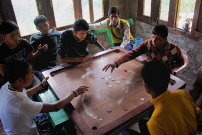 Boys play a game of carrom in Khati, in the state of Uttarakhand, northern India on June 28, 2012.