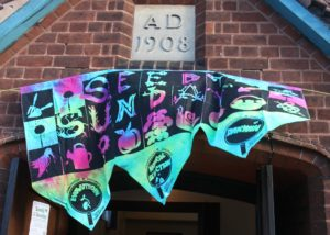 The Seedy Sunday banner at the entrance to the Village Hall