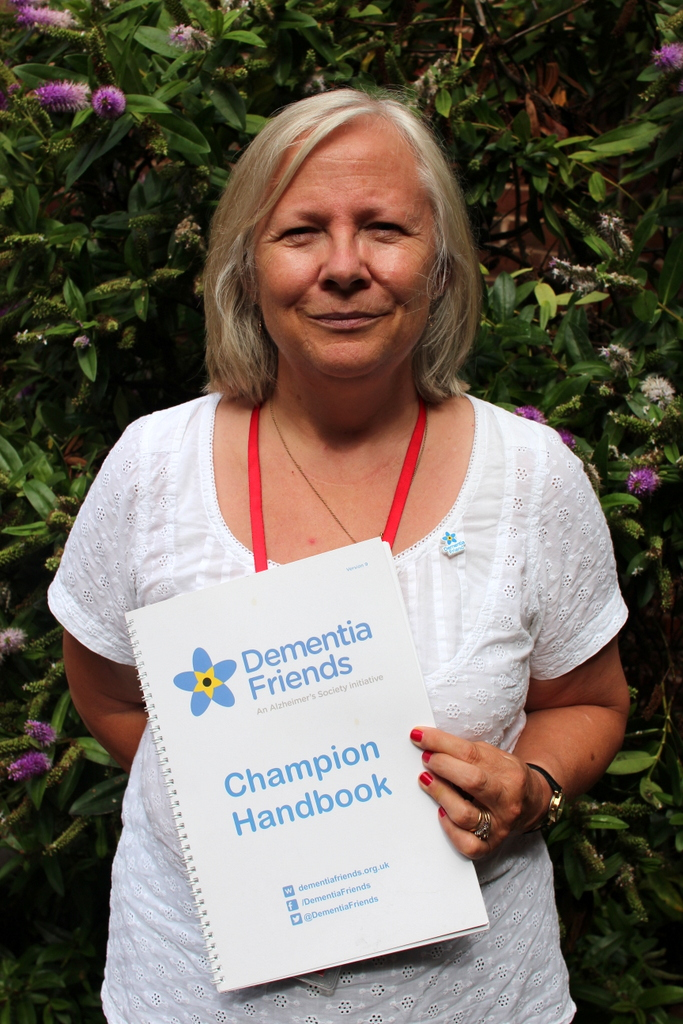 TDC's Sue Sayers with her Dementia Friends Champion Handbook