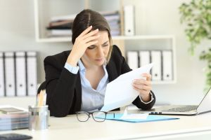 Woman is frustrated while looking at background check results