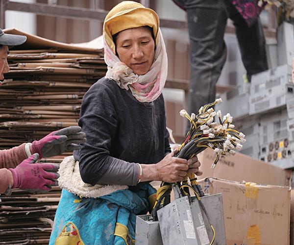 Woman carrying bitcoin mining asics machines, May 2021