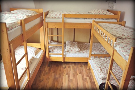many bunk beds in a room