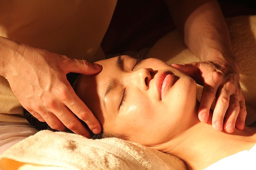woman getting massage on face