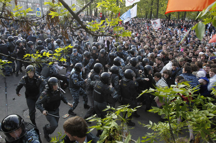 "Russian riot police scuffle with protesters during the ""march of the million"" opposition protest in central Moscow"