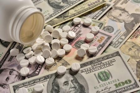 pills on top of money