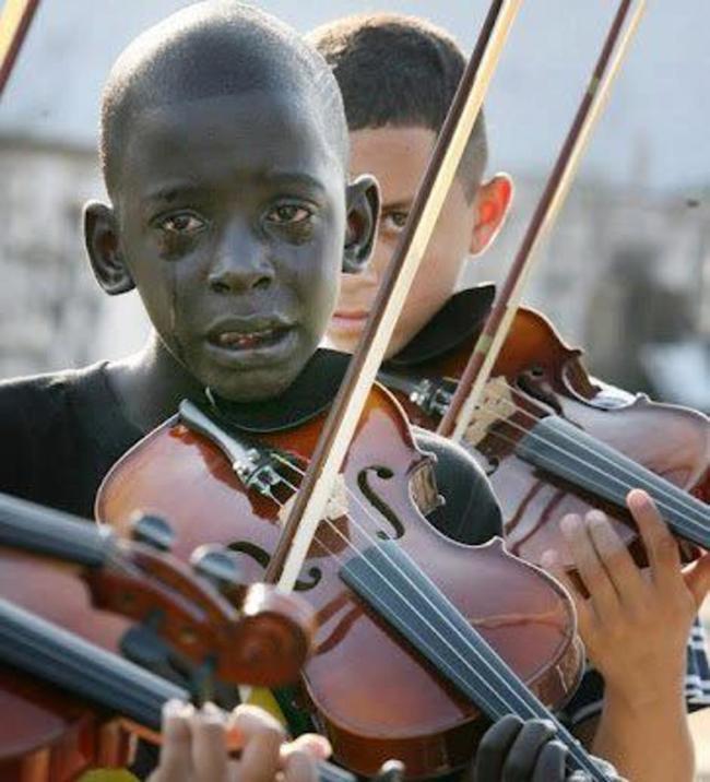boy plays violin