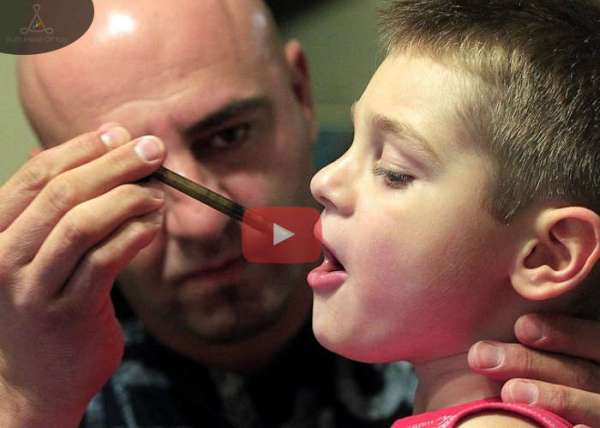 Dad-Giving-His-Sick-Son-Marijuana-Extract.