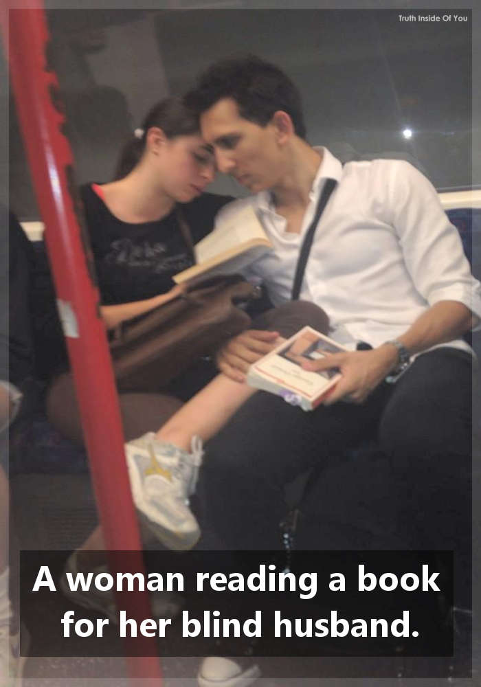 A woman reading a book for her blind husband