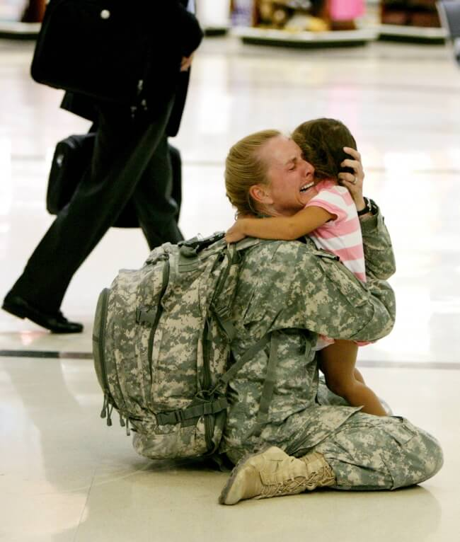 22. A mother soldier is finally hugging her kid.