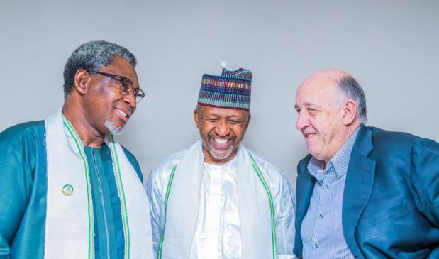 A Jolly Trio: From Left: Honorable Minister of Mines and Steel Development, Arc Olamilekan Adegbite, the Chairman, Board of the SMDF, Mr U. S. Malami, and a mining enthusiast, Mr Graham Black at the ceremony.