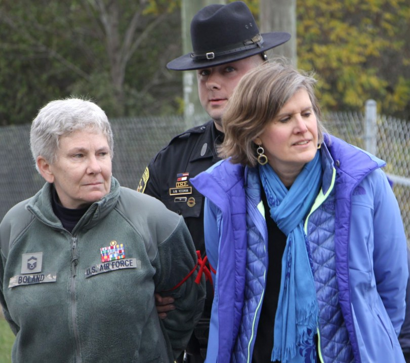 Colleen Boland, left, and Sandra Steingraber are detained by a Schuyler County sheriff's deputy at a protest in the Town of Reading, 2014. Photo: We Are Seneca Lake