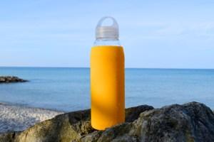 Daniel Glass yellow glass bottle