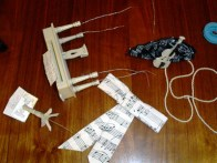 Musical instruments wired to attach to wig, plus bows & cockade