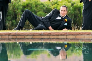 "Eric's impromptu ""Playgirl pose"". You can't ask for a better groom than that!"