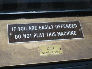 """If you are easily offended, do not play this machine. 25 cents"""