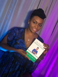 author of liberated lifestyle holding book