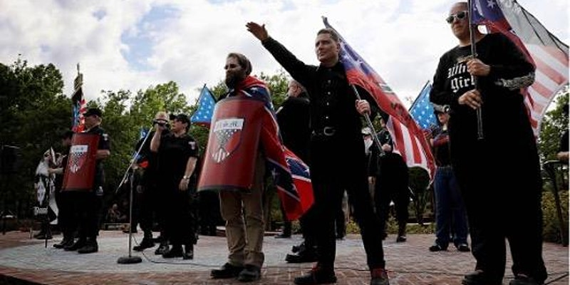 men protesting with US flags