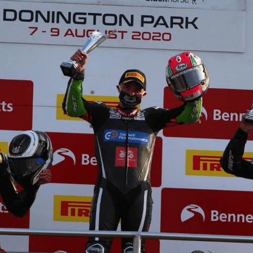 Chrissy Rouse celebrates his BSB win, with a smile behind the Chasin Face Mask