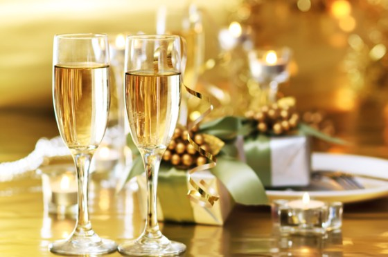 Two champagne glasses on dinner table