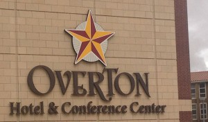 Signage of the Overton Hotel and Conference Center off of Mac Davis Lane, which can be seen from the stadium
