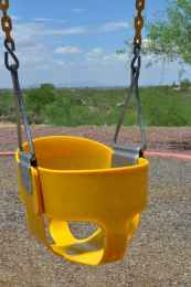 swings at Coyote Creek playground