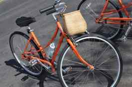 orange bicycle with basket