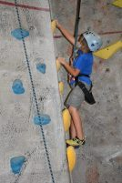 boy climbing at Rocks and Ropes