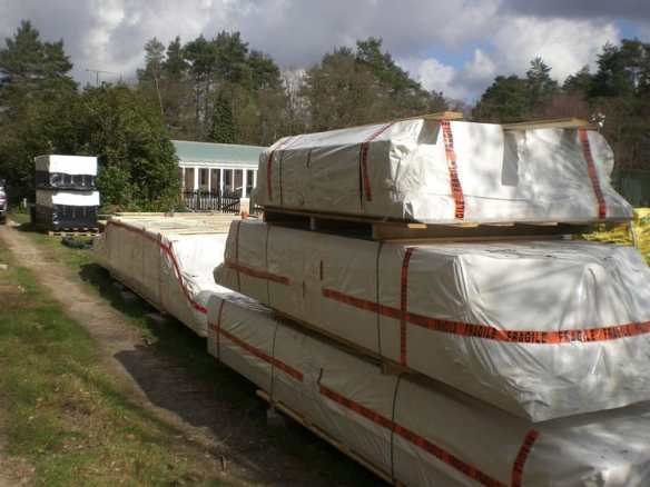 A log cabin generally arrives in packages such as these and are protected from the elements