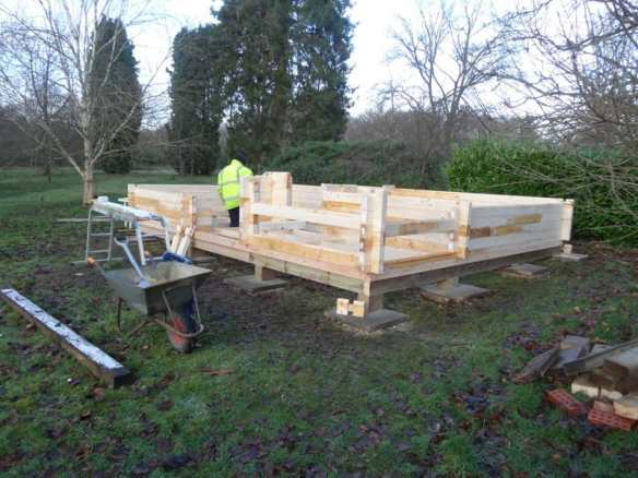 Building the Edelweiss log cabin on the stilt timber base