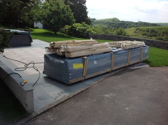 Floors, shingles, foundation beams, fitting kit of nails, clouts, etc will be on top of the package or delivered on a pallet to the side.
