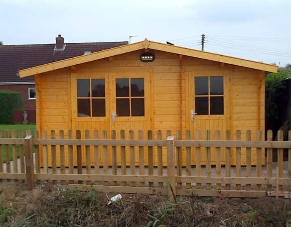Mr W new log cabin with integral shed.