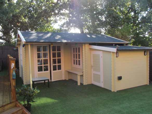 Johan log cabin with a shed extension added to the front. This extension can be placed on most walls as required at installation.