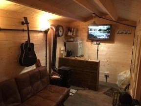 An Interior View Of The Justine Log Cabin