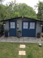 Lukas Log Cabin - Painted in grey and blue