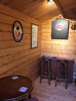 Dart board in the Peter Log Cabin