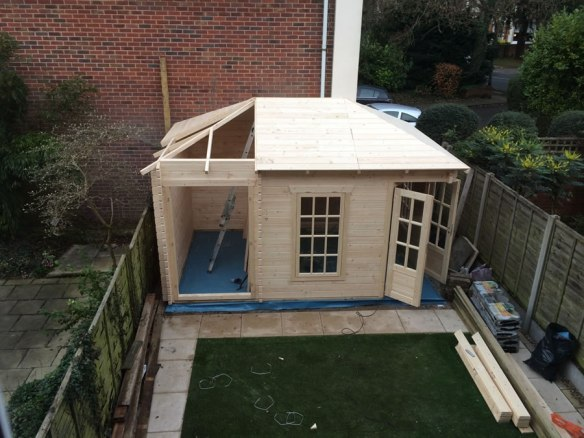 The tongue and groove 18mm roof boards are placed into position and nailed to the roof joists