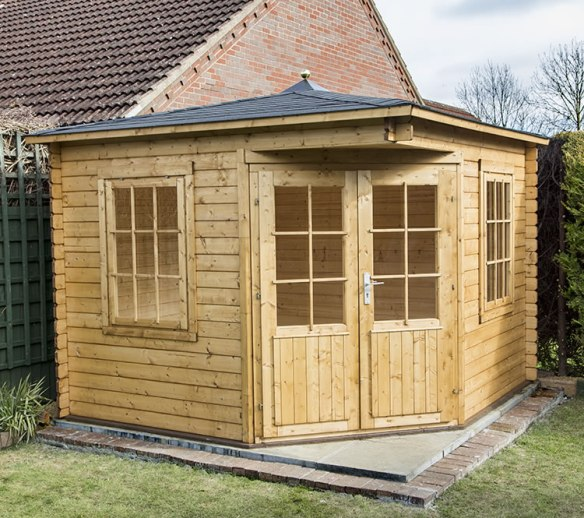 The completed Asmund log cabin. Please also see Mr L has fitted a finial.