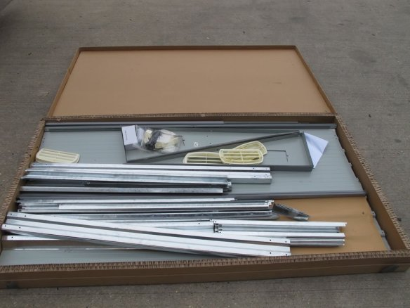 Metal shed box and contents