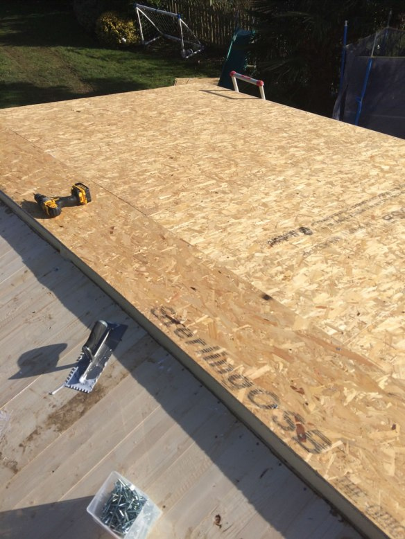 Philip uses thicker insulation and then sandwiches it using OSB sheets on the 58mm Wigan log cabin.